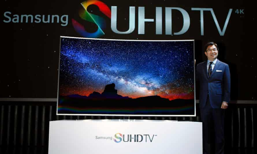 Kim Hyun-seok, head of Samsung Electronics' television division, poses for photographs with a Samsung Electronics S'UHD smart TV during its launch event in Seoul February 5, 2015.