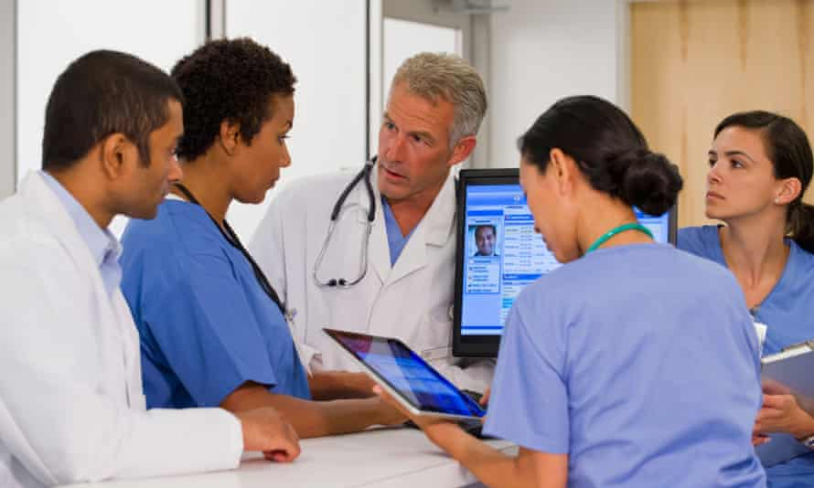 Doctors and nurses at a computer