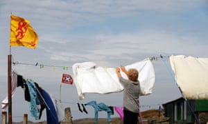 A woman hangs out her washing on the Isle of Lewis in the Outer Hebrides September 11, 2014.