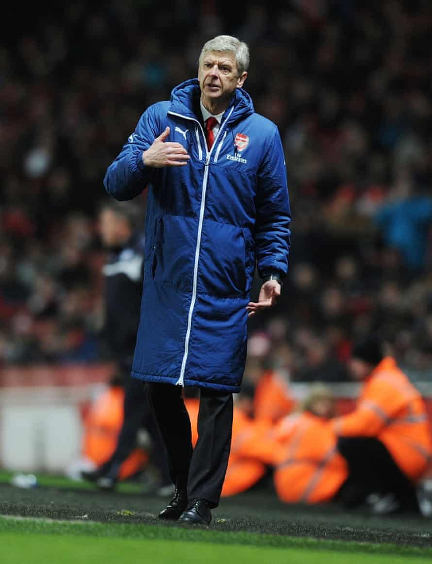 Arsène Wenger in his famous long coat