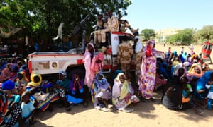 Women sit near a vehicle of the special police forces after it arrived in Tabit village in North Darfur November 20, 2014. The joint peacekeeping mission in the region known as UNAMID has been trying to gain access to visit Tabit since earlier this month to investigate media reports of an alleged mass rape of 200 women and girls there. Special Prosecutor for Crimes in Darfur Yasir Ahmed Mohamed and his team, accompanied by a military convoy of government forces, began initial investigations into the allegations on Wednesday.