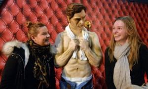 Visitors with a lifesize cake tribute to Fifty Shades of Grey in Manchester.