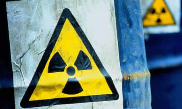 Blue drums displaying Radioactive sign, trefoil nuclear sign, radiation sign, symbol, looking like nuclear waste