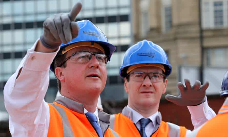 David Cameron and George Osborne tour building works at Manchester's Victoria Railway Station in June, 2014.