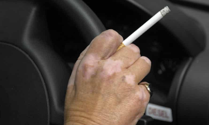 Driver holding a cigarette