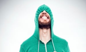 See no evil: a young person (possibly) pulls down his hood and hopes the politicians leave him alone.