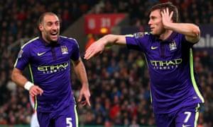 James Milner celebrates scoring Manchester City's second goal against Stoke with his team-mate Pablo Zabaleta.