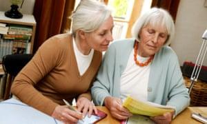 Pensioners looking at paperwork