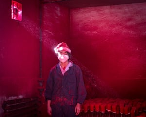 Christmas factory by Ronghui Chen won 2nd prize singles for Contemporary Issues. It shows a worker at a Christmas decoration factory, in China.