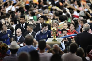 The final game by Bao Tailiang won 1st prize in the Sports singles category. Argentina player Lionel Messi looks at the World Cup trophy during the final celebrations at Maracana Stadium in Rio de Janeiro, Brazil.