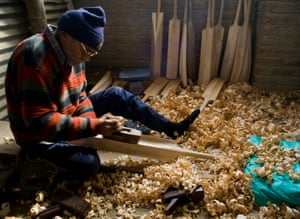 A worker shapes the bat