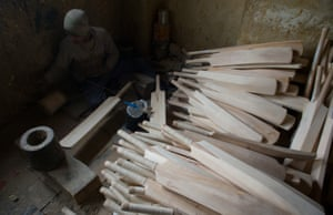 The handles of the cricket bats are looped with thread