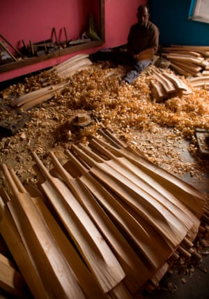A pile of shaped bats with handles
