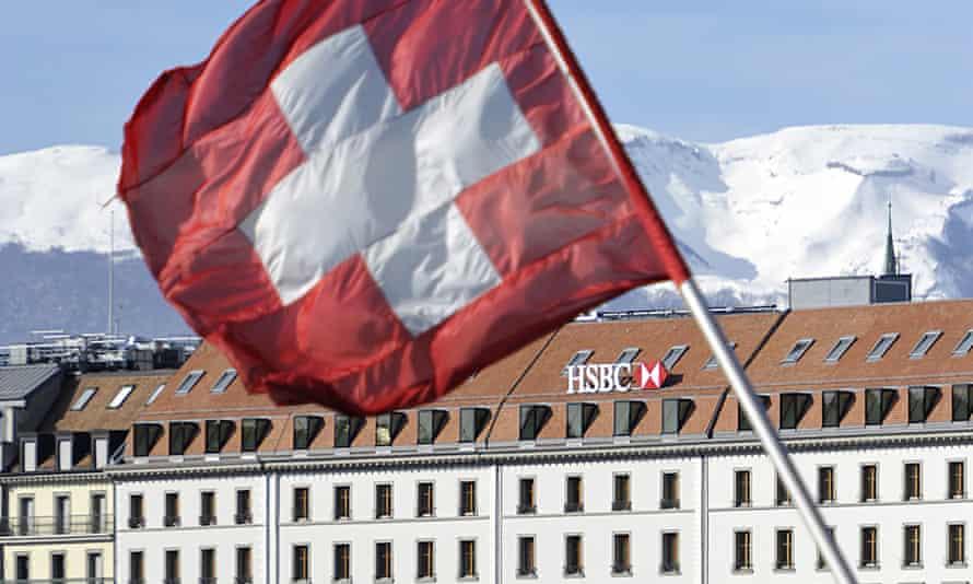 A Swiss flag flies above a HSBC logo