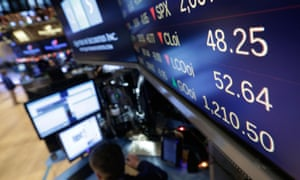 A board above the floor of the New York Stock Exchange shows the intraday price of oil, top, January 6, 2015. Stocks turned lower in mid-morning trading Tuesday, extending a slump from a day earlier. The price of oil continued to slide and the yield on the 10-year Treasury note fell below 2 percent.