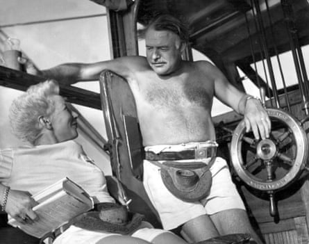 Ernest Hemingway and his wife Mary relax in the cabin of their fishing boat, Pilar.