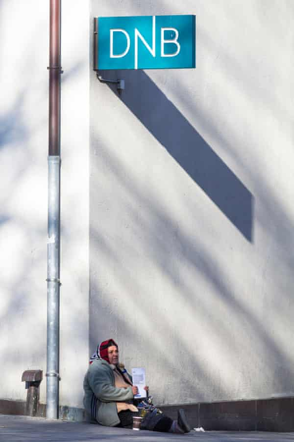 A woman begging outside a Den Norske Bank (DNB) branch in Stavanger, Norway.