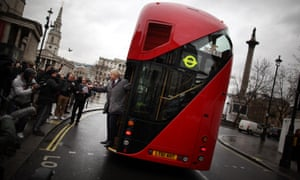 London Mayor Boris Johnson waves from a new prototype red double decker bus at Trafalgar Square in London in 2011.