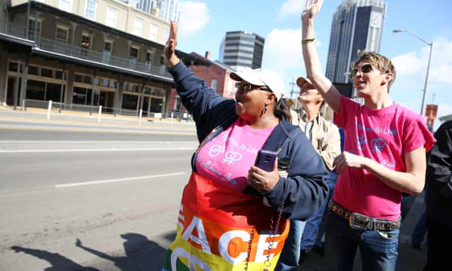 Gay marriage supporters rally in front of Mobile County probate court on Tuesday.