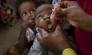 A child in Mogadishu receives drops during the intensive vaccination campaign against wild polio that has helped Somalia check the disease.