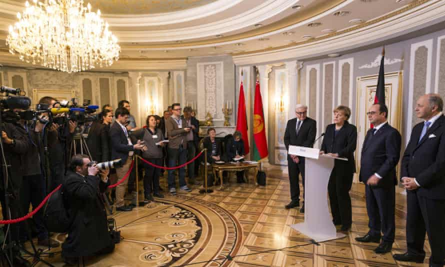 In Minsk, the media is briefed by (L-R) German foreign minister Frank-Walter Steinmeier and chancellor Angela Merkel, French president François Hollande, and French foreign minister Laurent Fabius.