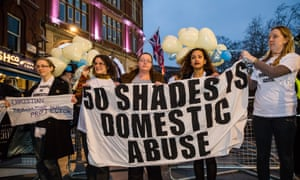 Campaigners against domestic violence demonstrating at the London premiere of Fifty Shades of Grey.