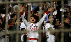 A member of the Ultras White Knights cries during Zamalek's match with and ENPPI in Cairo.
