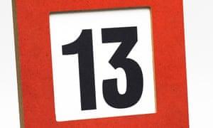 A desk calendar showing Friday 13