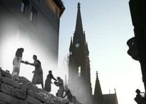 Women carrying bricks outside Martin Luther church