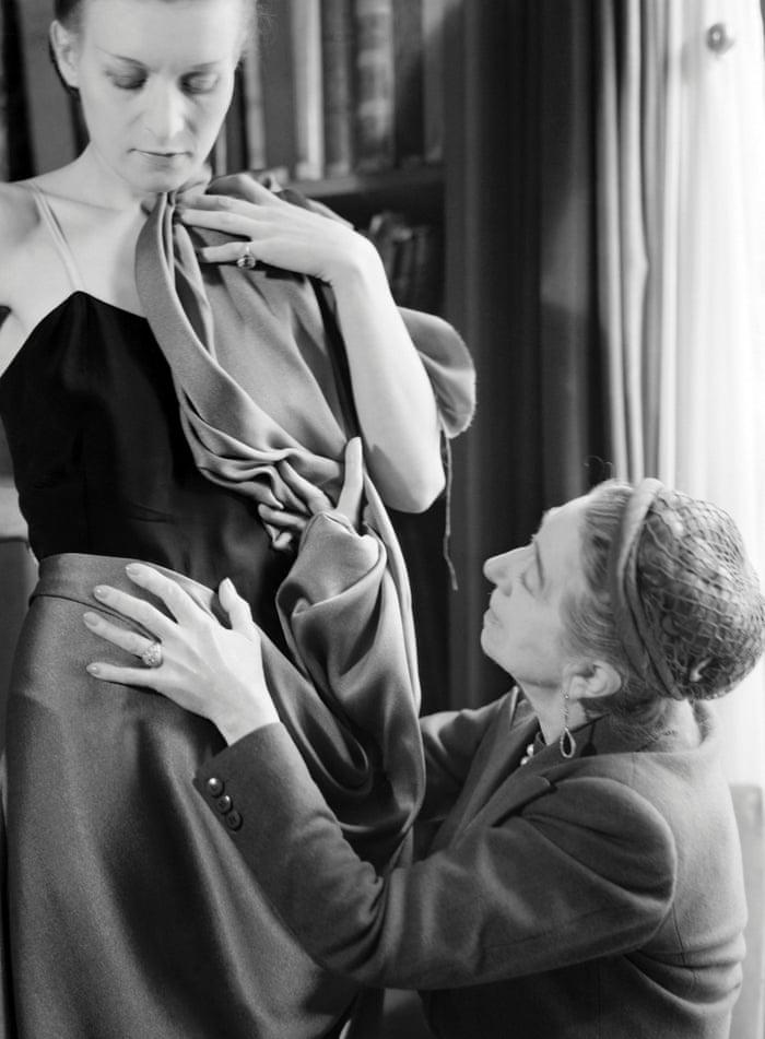 Madame Lanvin, dressing a model