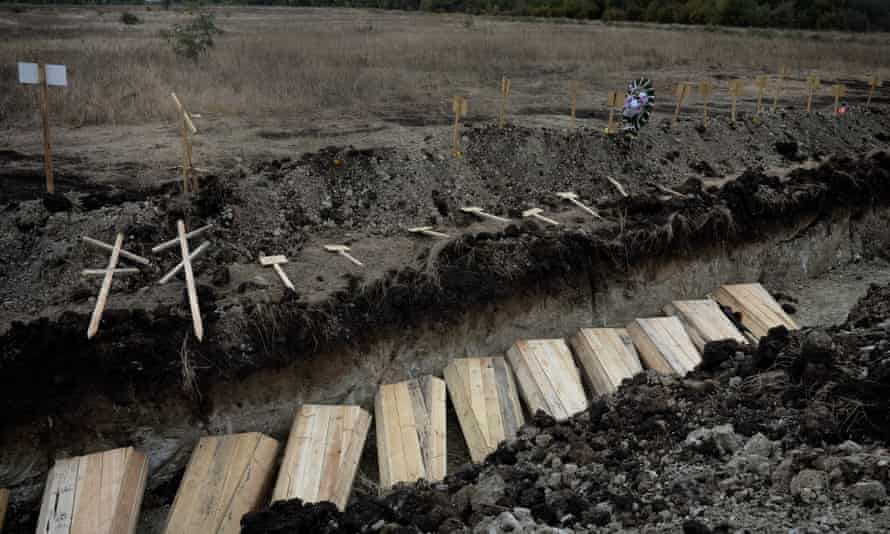 A mass grave on the outskirts of Luhansk, for victims of mortar and shelling attacks.