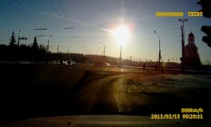 A dashboard camera records the meteorite streaking through the sky over Chelyabinsk Friday, 15 February 2013.