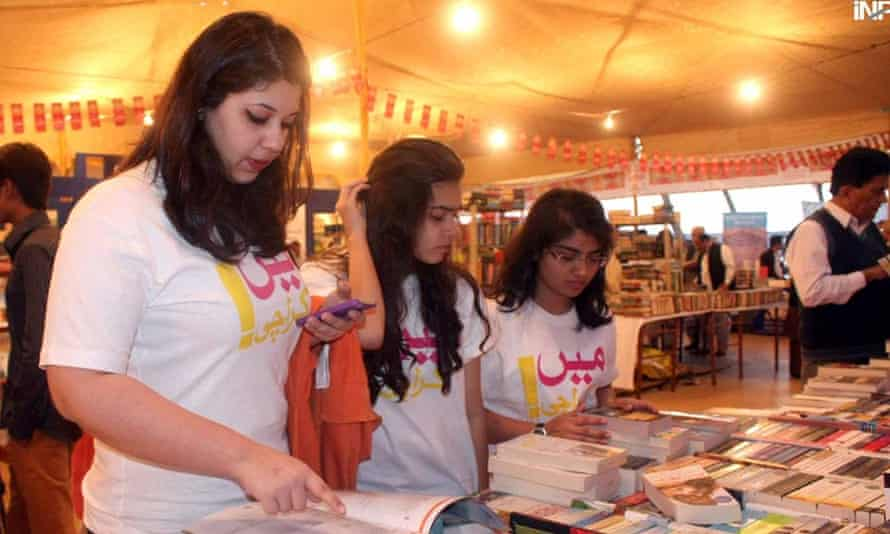Young women look at the books available at the Karachi literature festival.