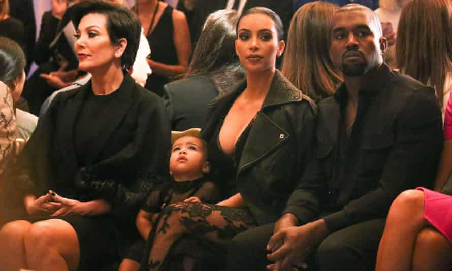 Kim Kardashian and Kanye West at a Paris fashion week show with baby North West