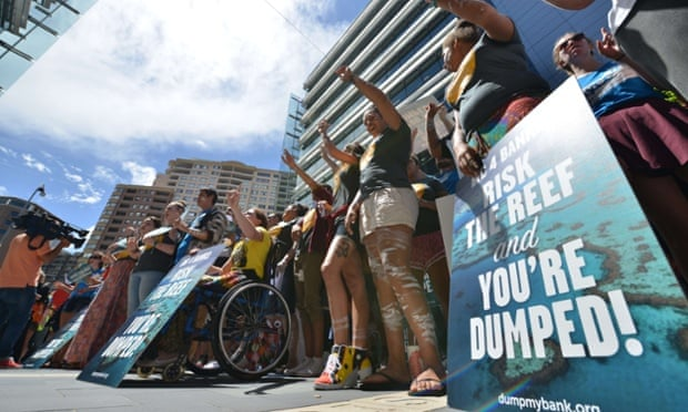 Demonstrators outside the headquarters of Commonwealth Bank in Sydney to protest at plans  for coal port coal expansion on the Great Barrier Reef as part of Global Divestment Day.