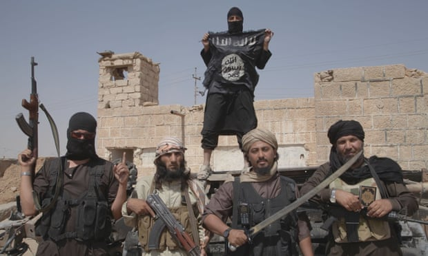 Isis fighters on the border between Iraq and Syria.