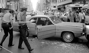 New York police deal with the aftermath of a shooting in 1976, when there were more than 1,600 murde