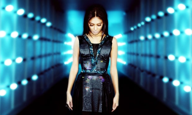 Nicole Scherzinger wears CuteCircuit's Twitter Dress at the launch of EE's 4G mobile network at Battersea Power Station in London.