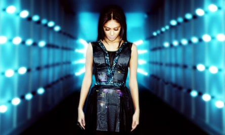 Nicole Scherzinger wears CuteCircuit's Twitter Dress at the launch of EE's 4G mobile network at Battersea Power Station in London.