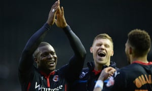 Yakubu and his Reading team-mates celebrate after their FA Cup win.