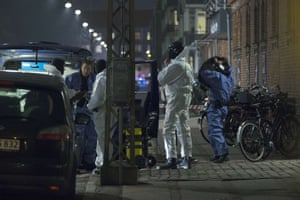 Police officers work at the area around the Krudttønden cafe in Copenhagen where shots were fired during a debate on Islam and free speech.