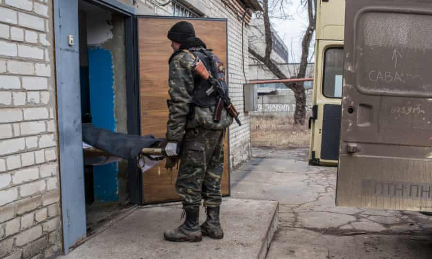 The body of a Ukrainian soldier killed in fighting is brought into the morgue on 14 February in Artemivsk.