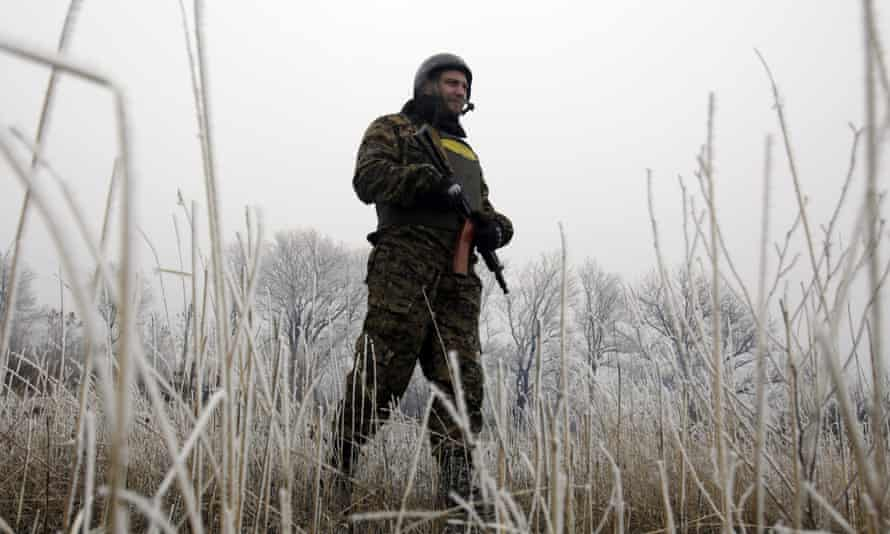 A Ukrainian soldier takes up a position not far from Debaltseve, on 14 February, where fighting has raged in recent days.