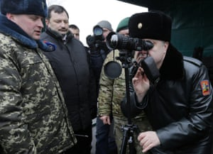 Through the looking glass: Petro Poroshenko, the Ukrainian president, during a visit to the state border guard service in Kiev.