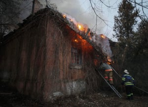 The impact still felt by civilians: here firefighters tackle a fire that has engulfed a building following shelling in Artemivsk.