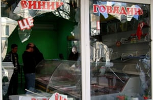 Damage needing repairs: a shop window is seen broken following shelling in the centre of Donetsk.