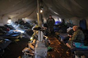 The fatigue of conflict: Ukrainian servicemen take a rest from their duties in their camp near Donetsk.