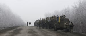 An uneasy wait: Ukrainian military convoy stopped on the road between the strategically important towns of Debaltseve and Artemivsk.