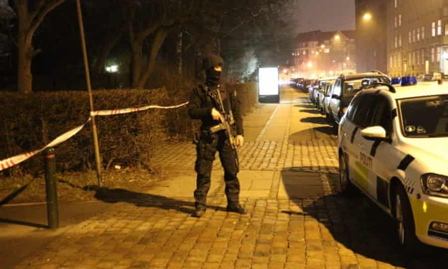 An armed policeman on guard at the site of the attack.