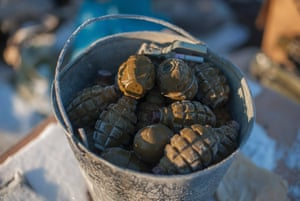 On edge: a bucket filled with grenades waiting to be primed sits at a Ukrainian position not far from Bakhmutka.
